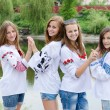 Four happy teenage friends posing in handmade blouse — Stock Photo #37108889