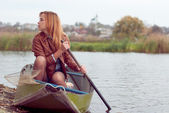 Young woman on a boat — Stock Photo