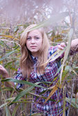 Beautiful blond woman in reed — Stock Photo
