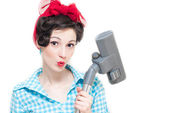 Pinup woman and vacuum cleaner — Stock Photo