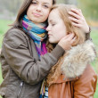 Stock Photo: Brunette and red haired girls