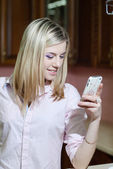 Lovely young woman using mobile phone — Stock Photo