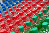 Image of many plastic bottles with water in a shop — Stock Photo