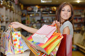 Young beautiful woman holding shopping bags — Stok fotoğraf