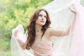 Woman with white silk scarf — Stock Photo
