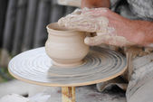 Craftsman making vase from fresh wet clay on pottery wheel — 图库照片