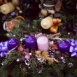 Stock Photo: Christmas candles on pine garland