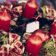 Stock Photo: Christmas candles on pine garland decoration
