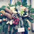 Christmas pine tree garland with cones and flowers decoration — Stock Photo