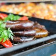 Various Hungarian sausages on a counter — Stock Photo