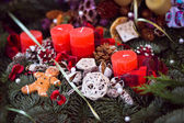 Christmas candles on pine garland decoration — Stock Photo