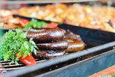 Various Hungarian sausages on a counter — Stock Photo