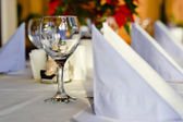Restaurant table layout with row of wineglasses — Stock Photo