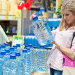 Woman buys a bottle of water — Stock Photo #38800201