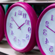 Stock Photo: Wall clocks on the shelf