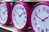 Wall clocks on the shelf — Stock Photo