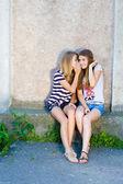 Two teenage girls sharing secret — Stock Photo