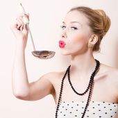 Happy pinup woman with ladle — Stock Photo