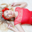 Beautiful funny young blond pinup woman happy — Stock Photo