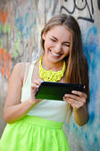 Woman reading message on tablet pc — Stock Photo