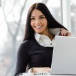 Young business woman using laptop PC at office — Stock Photo #41143477