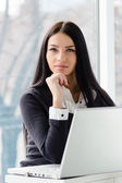 Young business woman using laptop PC at office — Stock Photo