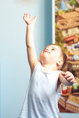 Little boy toddler reaching up at home — Stock Photo