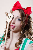 Funny pinup woman showing tongue abd holding kitchen ware — Stock Photo