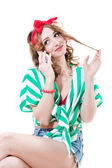 Funny pinup woman speaking on mobile — Stockfoto
