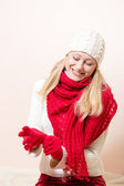 Pretty happy woman wearing red knitted scarf and gloves — Stockfoto