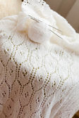 Closeup detail of woven handicraft knit white sweater — Stock Photo