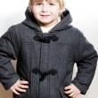 Little boy wearing coat and cap — Stock Photo