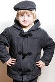 Little boy wearing coat and cap — Stock Photo