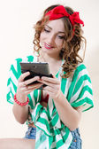 Beautiful pinup woman holding tablet pc computer & happy smiling over white background — Stock Photo