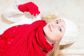 Pretty happy woman wearing red knitted scarf and gloves — Стоковое фото