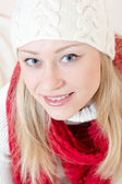Pretty happy woman wearing red knitted scarf and gloves — Stock Photo