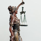 Side of themis, femida or justice goddess sculpture on white — Stock Photo