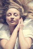Woman basking sun in bed — Stock Photo