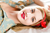 Girl with red lipstick looking at camera — Stock Photo