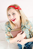 Smiling girl  with book — Stock Photo