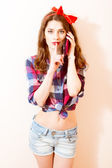 Girl shows a sign quietly and talking on the phone — Stock Photo