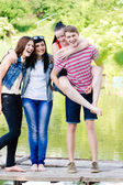 Teenage friends having fun outdoors — Stock Photo