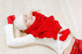 Beautiful happy smiling blond & blue eyes young woman wearing red knitted gloves and shawl looking at camera — Stock Photo