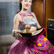 Woman  smiling and baking yummy cake — Stock Photo #43495141