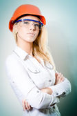 Woman with a helmet on her head and glasses — Stock Photo