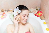 Woman  relaxing in the bath — Stock Photo