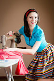 Woman  with hands on sewing machine — Stock Photo