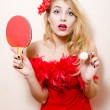 Woman with flower in hair and bat ball for table tennis — Stock Photo #44562875
