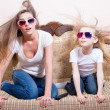 Woman with little girl watching 3D movie in 3D glasse — Stock Photo