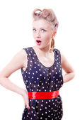 Woman in polka dot dress with curlers — Stock Photo